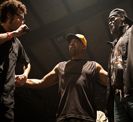 Director Reda Zine on stage with Chuck D, Malik Farrakhan